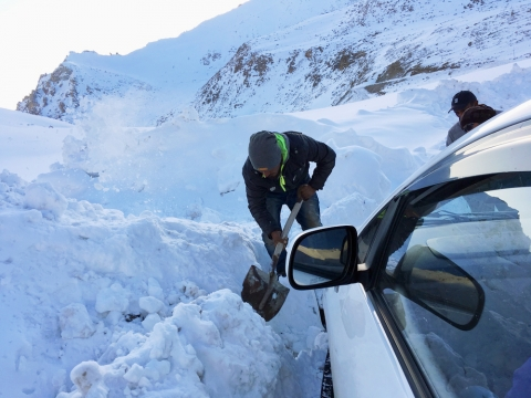 Digging out car stuck in snow bank