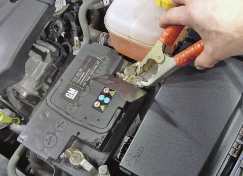 04 Connect one end of the red jumper cable to the positive terminal on the dead car's battery