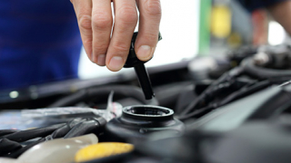 Checking your car's fluid levels: how long they should last and what it will cost you