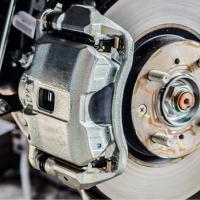 A brake caliper located on a brake disc