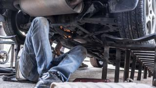 Car ramps being used by a mechanic