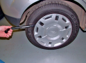 Remove the hub cap from the flat tyre, if fitted