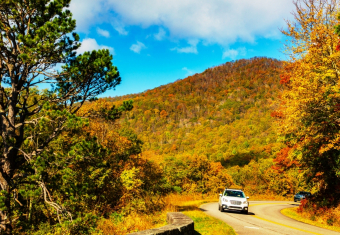 Driving through scenic autumn scene