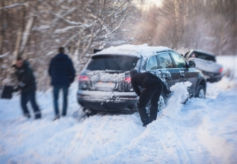 Minivan stuck in snow