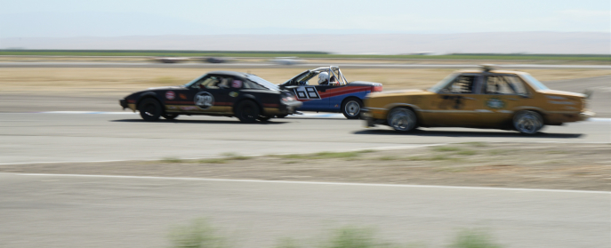 Ford Fairmont, Geo Metro, and Mazda RX7 in 24 Hours of Lemons Race