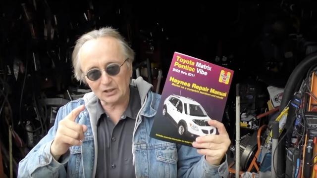 Scotty Kilmer with a Haynes Manual