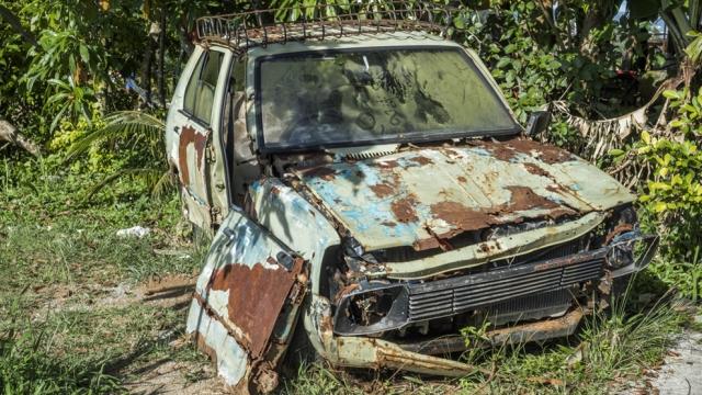 rusty car falling apart