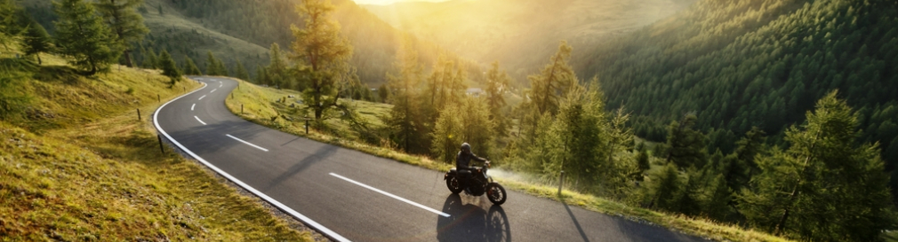 motorcycle cruising a mountain road