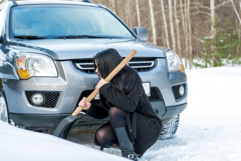 woman digs out her car stuck in snow