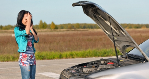 Broken down car with hood up