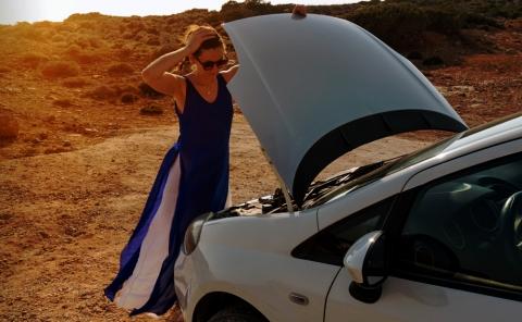 Women broken down car in desert