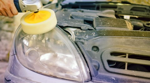 Using a polishing wheel and compound on headlight