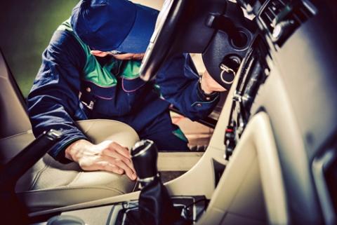 Examining the interior of a used car