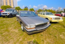 A Buick Roadmaster poses with a Plymouth Reliant K wagon, and a Mitsubishi Montero