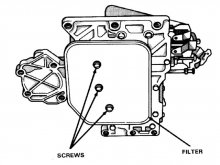 The transmission filter on early models is held by three screws. On 5-speed NAG1 the filter pulls straight out.