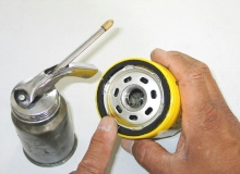 Lubricate the oil filter gasket with clean engine oil before installing the filter on the engine