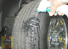 spray a soapy water solution onto the tread as the tire is turned slowly - leaks will cause small bubbles to appear
