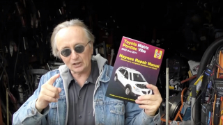 Scotty Kilmer with a Haynes Manual