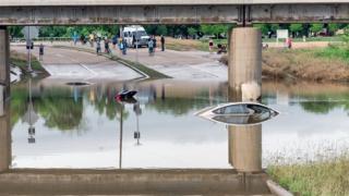 Car submerged under flood waters Texas