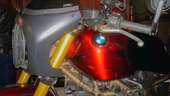 This custom cafe racer contrasts carbon fiber, matte gold on the frame, and a deep candy apple paint job on the tank