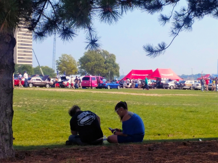 Period dressed show goers rest in the shade