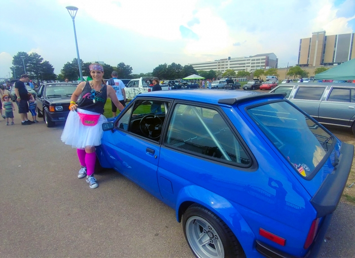 Tiny Toyota Starlet poses next to an 80s wannabe starlet