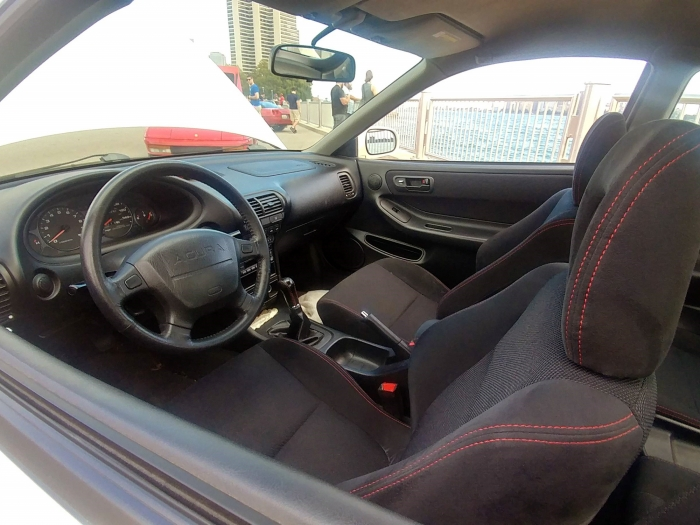 Grippy sport seats, precision shifter, and feedback galore from the wheel