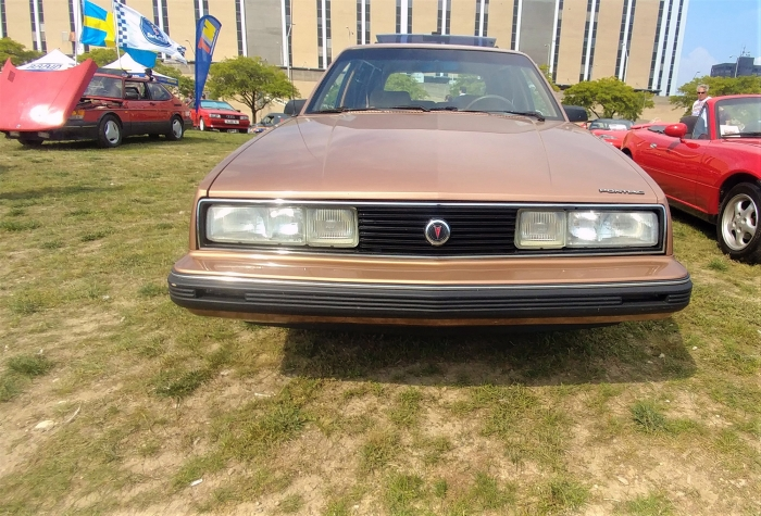 Saab 900 show off how weird it is compared to the traditional Pontiac and