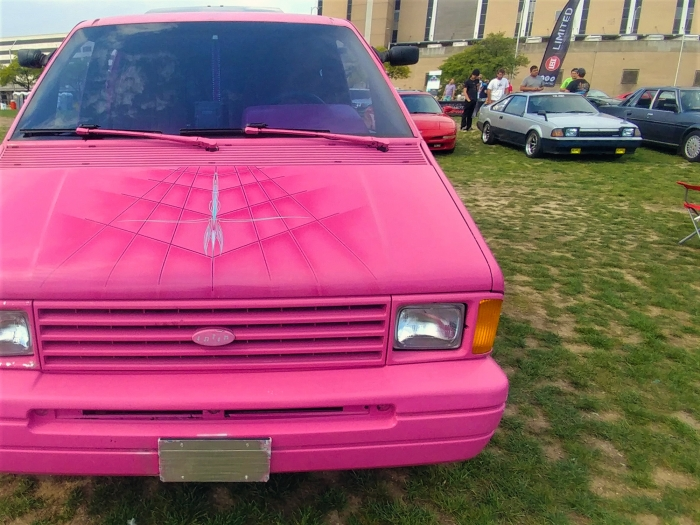 This minivan lived a life of leisure, with a flashy paint job and job advertising a car stereo store