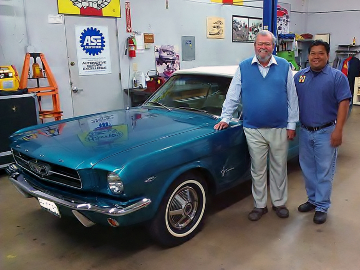 John Haynes and Jamie with the restored Mustang