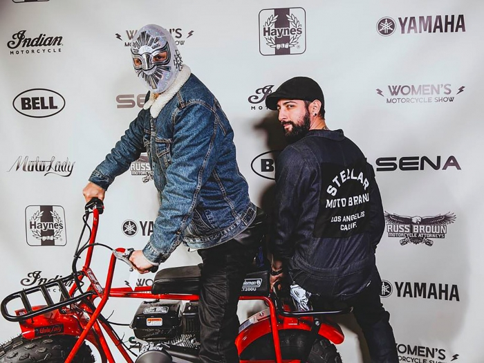 Masked Instagrammer and friend pose on the Coleman minibike red carpet