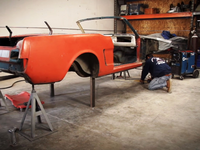A custom built wheeled platform allows the shell to be easily moved around the shop
