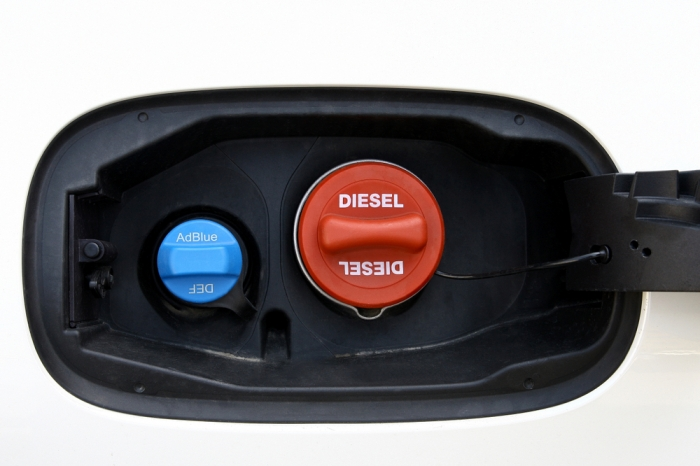 Most vehicles have a monitor or gauge. If taking a long trip, fill DEF reservoir while getting fuel.
