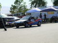 Geo Metro sitting in the pits with its new rad racing paint