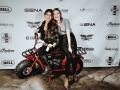 Instagrammer and friend cruise the red carpet on a Coleman minibike